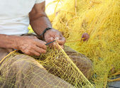 Fisherman Mending His Fishing Net in Greece — Stock Photo