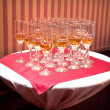 A row of champagne glasses — Stock Photo