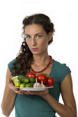 Girl with vegetables in your hands — Stock Photo