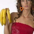 Girl with three bananas in hand — Stock Photo