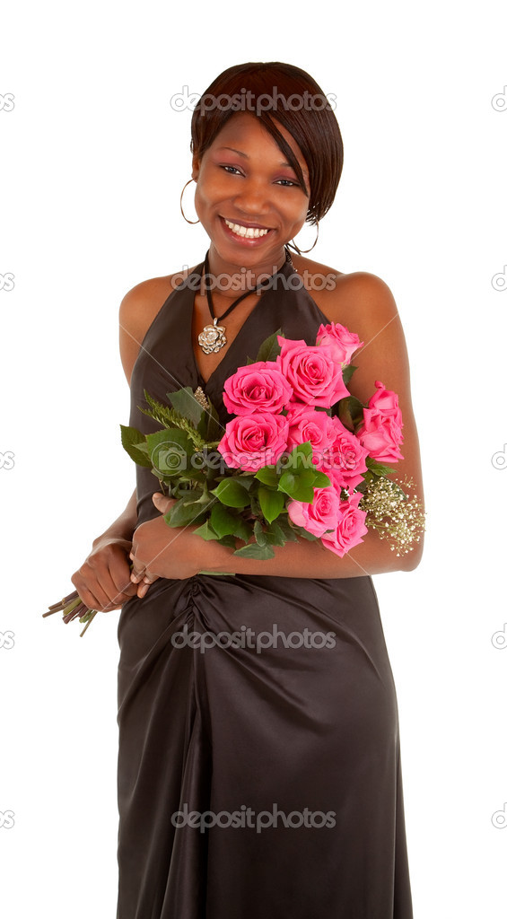An happy african american woman is posing with her roses. — Stock Photo #7268410