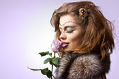 Beauty with rose — Stock Photo