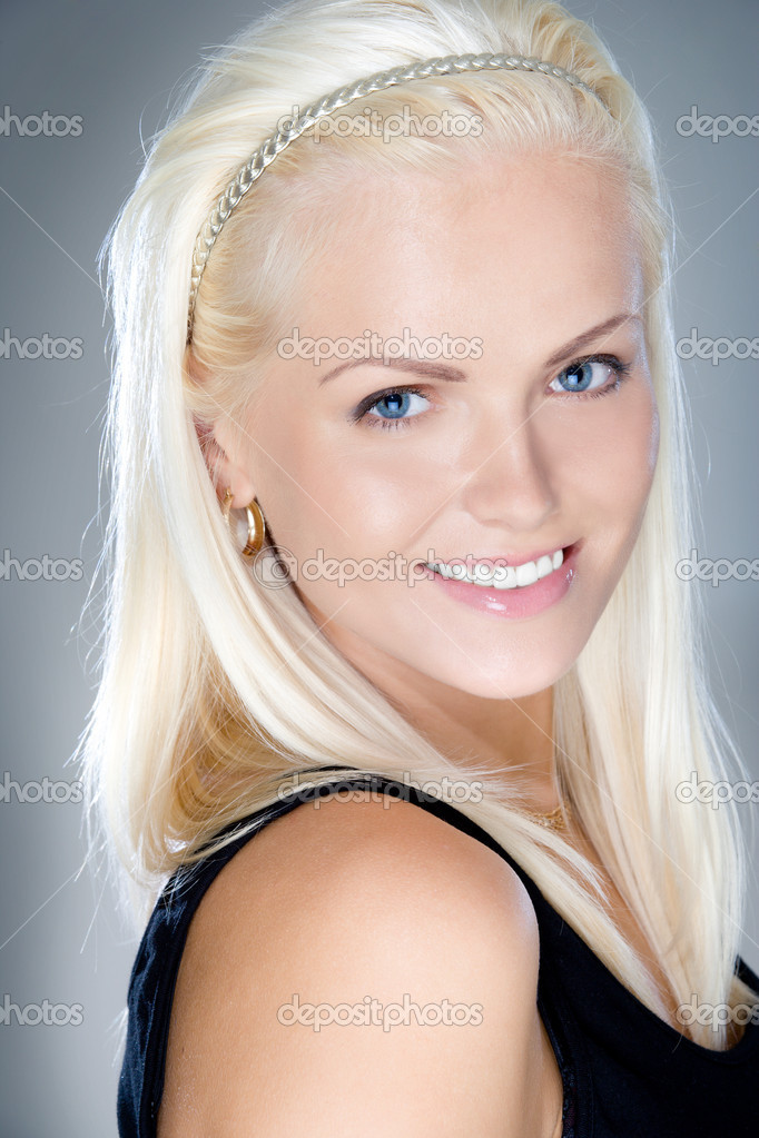Young and fresh blonde smiling, studio shot — Stock Photo #6813500