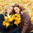 Outdoor portrait of two young women — Stock Photo