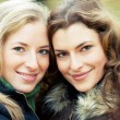 Two young women in the park — Stock Photo