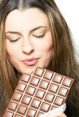 Njuter av choklad — Stockfoto
