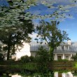 Stock Photo: Reflection of nature in pond of botanic garden in tartu, estonia