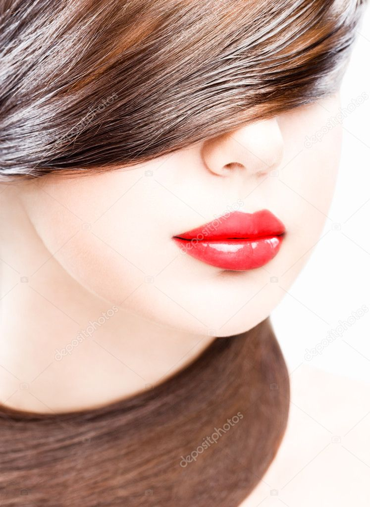 Close up studio portrait of young woman, wearing red lipstick — Stock Photo #7085755
