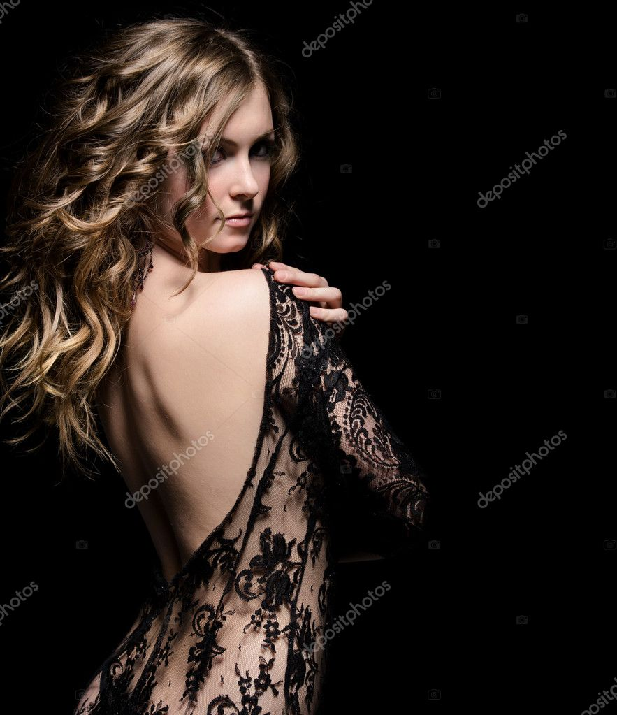 Young gorgeous lady posing in lace dress, over black. space for copy  Stock Photo #7085805