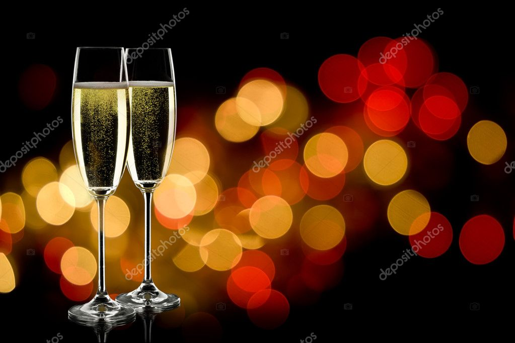 Two glasses of sparkling wine with copyspace and abstract lights background  — Stock Photo #7188161