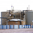 Oil and water storage at an oil well location — Stock Photo