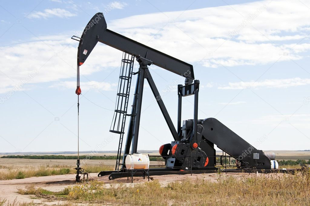 Raised pump jack in south central Colorado, USA, ready to start the down stroke to load the lifting pump with crude oil.  Stock Photo #6933415