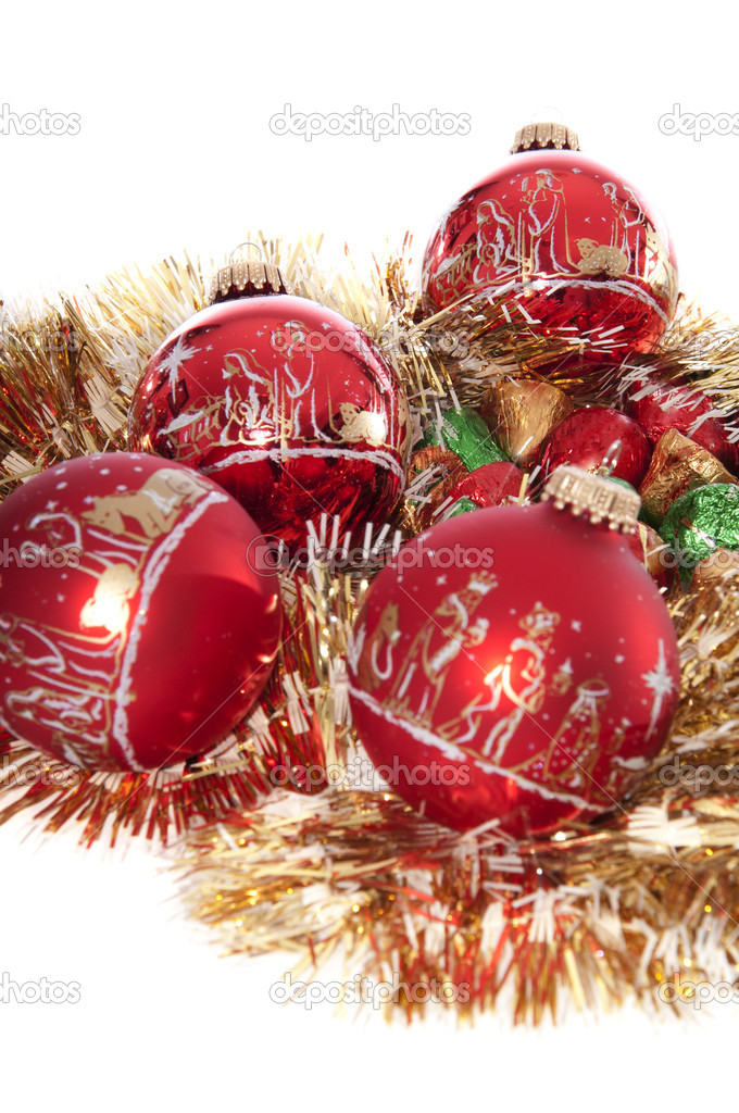 Christmas ornaments and candy isolated on a white background. Ideal for a Christmas card. — Stock Photo #7549364