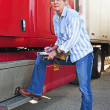 Pretty Woman Inspecting Truck — Stock Photo