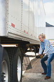 Woman Truck Driver Raising Trailer legs — Stock Photo