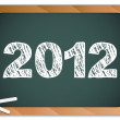 2012 New Year written on blackboard with chalk - Stok Vektör