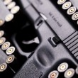 Stock Photo: Ammunition and automatic handgun