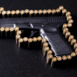 Ammunition and automatic handgun — Stock Photo #7119742