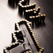 Ammunition and automatic handgun — Stock Photo #7119817