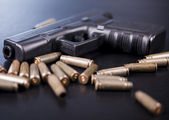 Ammunition and automatic handgun — Stock Photo