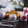 Christmas background with baubles and gift — Stock Photo #7120945
