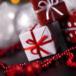 Christmas background with baubles and gift — Stock Photo
