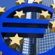 Stock Photo: Euro sign and city