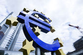 Euro sign and city — Stock Photo