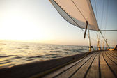 Ropes on wooden and Yacht — Stock Photo