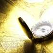 Antique brass compass over old map — Stock Photo