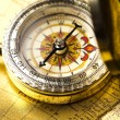 Antique brass compass over old map — Stock fotografie #7170398