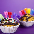Cupcakes spelling out happy birthday — Stock Photo #7171077