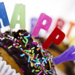 Cupcakes spelling out happy birthday — Stock Photo #7173722