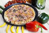Supreme pizza in pan — Stock Photo