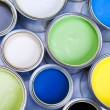 Cans and paint on the colourful background - Foto de Stock