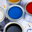 Cans and paint on the colourful background - Stockfoto