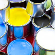 Cans and paint on the colourful background — Lizenzfreies Foto