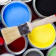 Cans of paint with paintbrush - Stockfoto