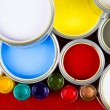 Cans and paint on the colourful background — Stock Photo
