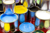 Cans and paint on the colourful background — Стоковое фото