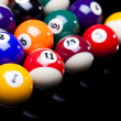 Billiard balls, cue on black table — Stock Photo