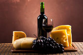 Cheese and red wine — Stock Photo