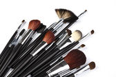 Set of professional makeup brushes on white background — Stock Photo