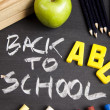 Apple on a chalkboard, healthy breakfast at school  — Stock Photo