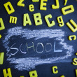 School background, letters and chalkboard — Stock Photo