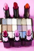 Lipsticks background — Stock Photo