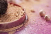 Face powder, make up powder on pink background — Stock Photo