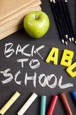 Apple on a chalkboard, healthy breakfast at school — Stock Photo