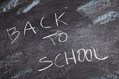 Zurück in die schule - inschrift auf der tafel — Stockfoto