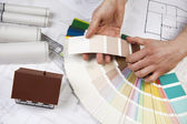 The achitecture plan in human hands — Stock Photo